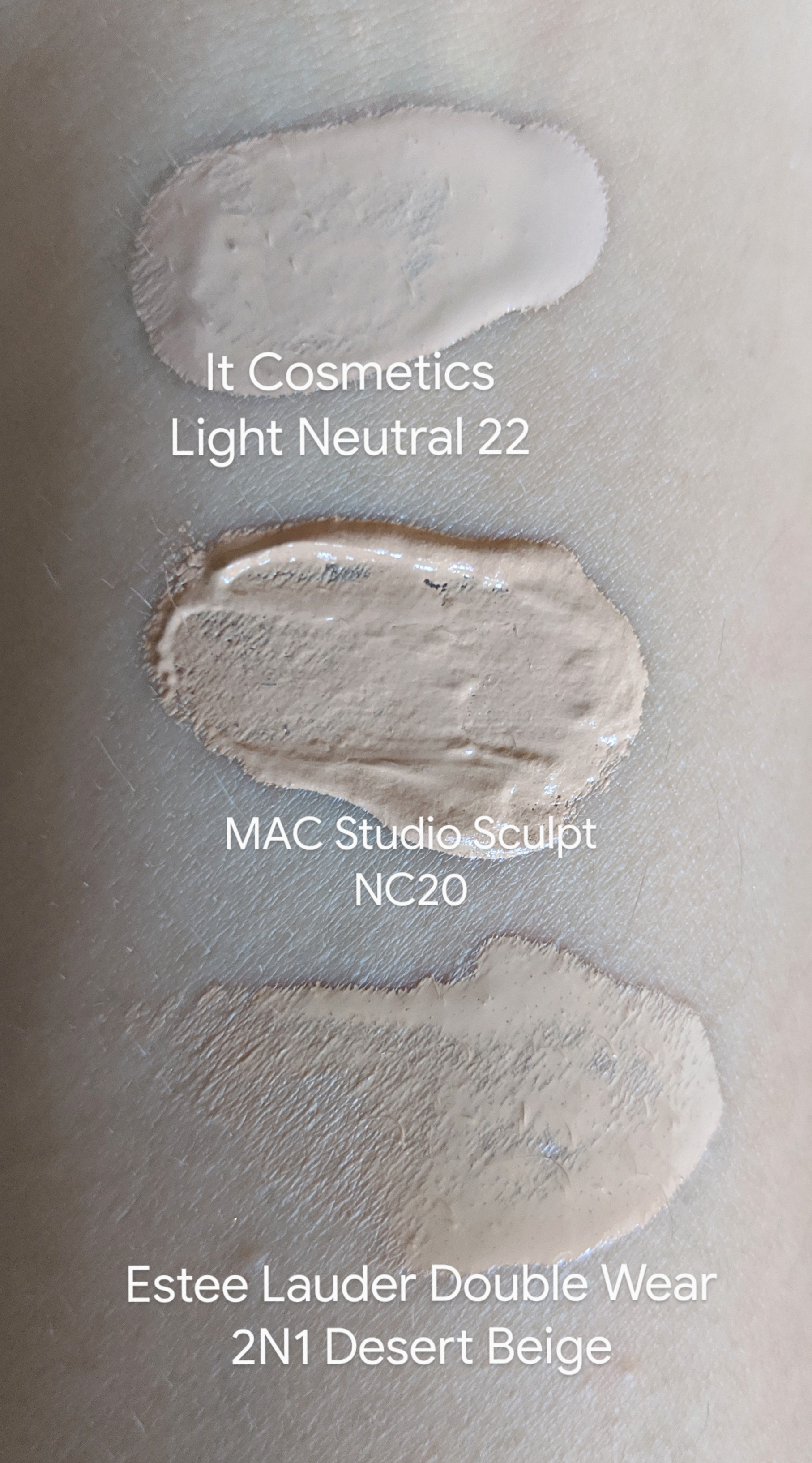 Michelle's foundation swatches from top to bottom: It Cosmetics Your Skin But Better Foundation + Skincare Light Neutral 22, MAC Studio Sculpt NC20, Estee Lauder Double Wear 2N1 Desert Beige